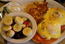 Smoked salmon benny's with potato latke and fruit salad.